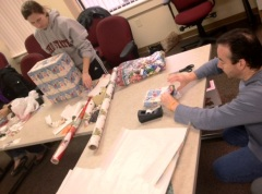 Suzanne Salupo and Fred Ferguson of Team xpedx help wrap gifts for Project Holiday Cheer!